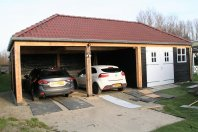 C2 Garage / carport 1100  x 500 dubbelwandig houtskelet / potdeksels, schilddak 30 graden
