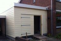 A9 Aanbouw garage dubbelwandig houtskelet - plat dak