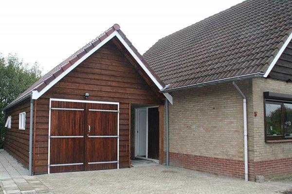 A6 Aanbouw / Garage 630x475cm dubbelwandig houtskelet bekleed met potdeksel