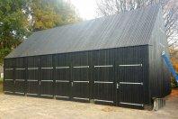 SP24 Garage 1175x600cm houtskeletbouw met daarop lariks latten zwart