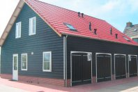 SP3-Studio-1270x1000-prefab-betonwanden-met-daarop-dubbelw.-houtskelet